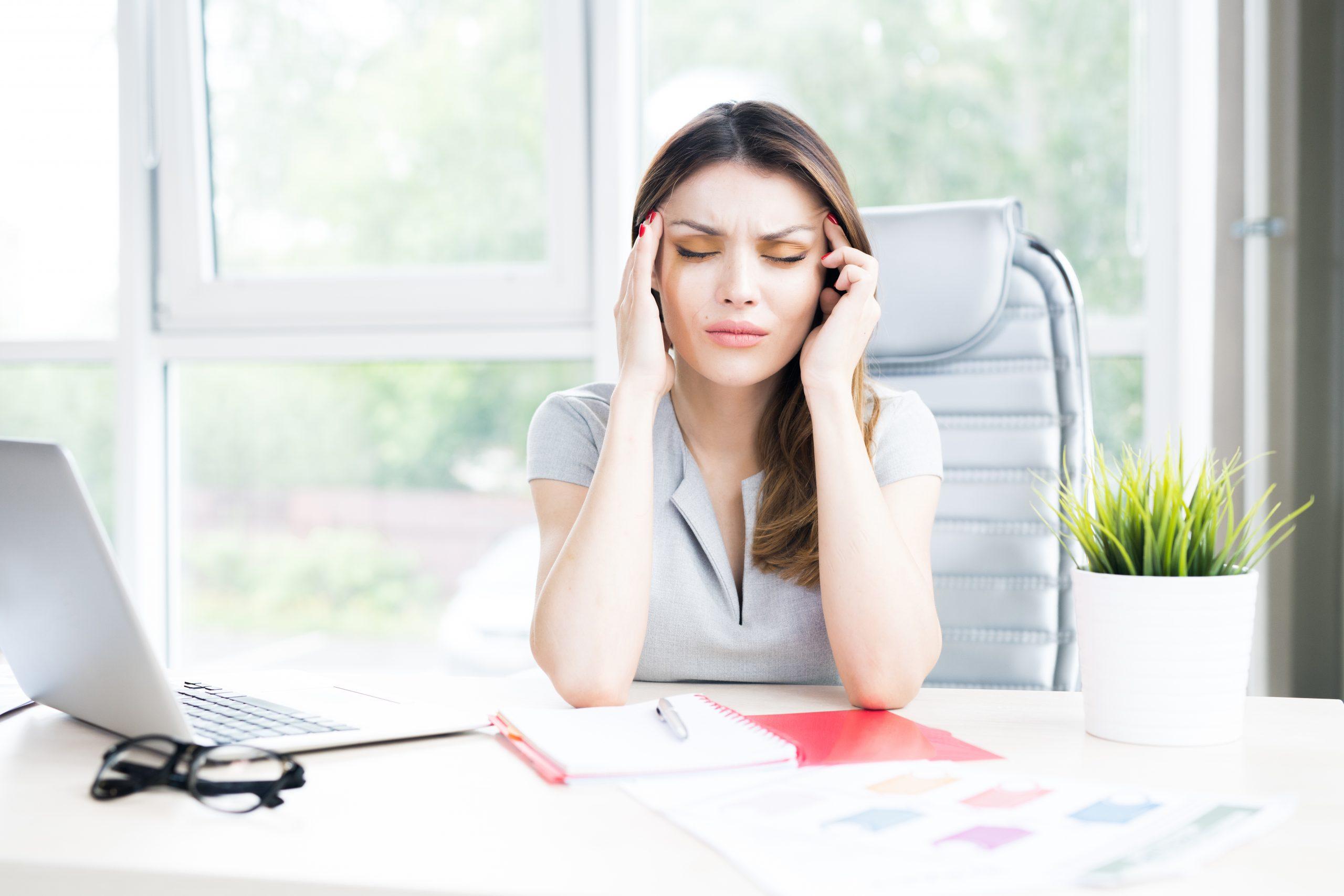 Modern Businesswoman Suffering from Headache