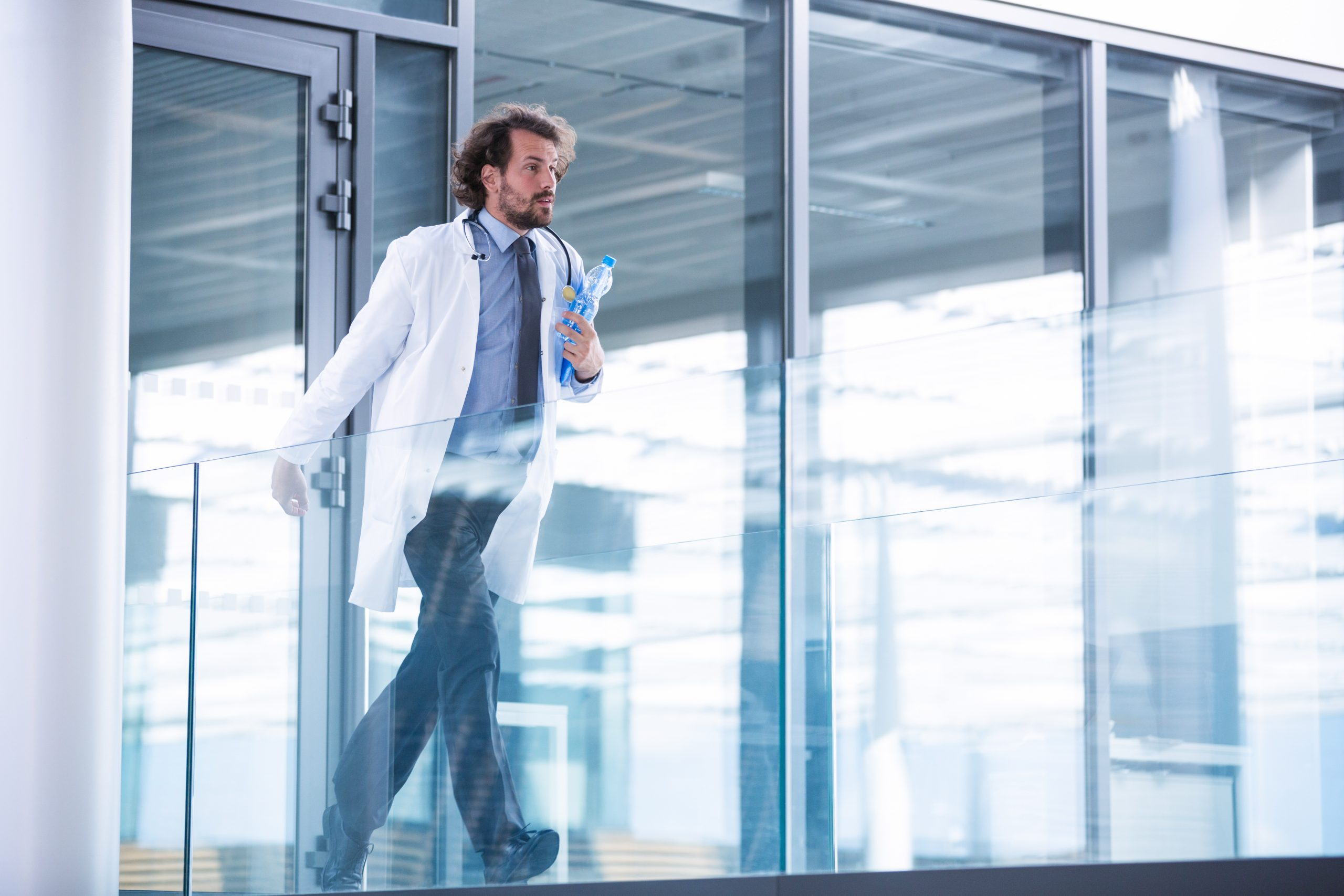 Doctor rushing in corridor
